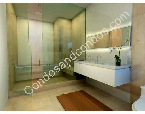 Seamless, enclosed glass shower and soaking tub