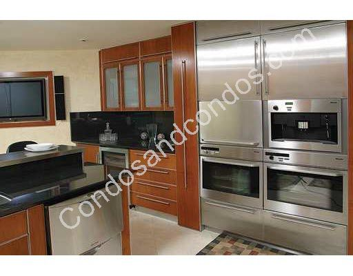 Kitchen with built-in double ovens and wine cooler