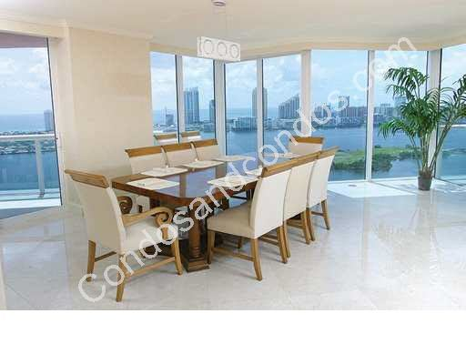 Formal dining space with window-walls over-looking the bay