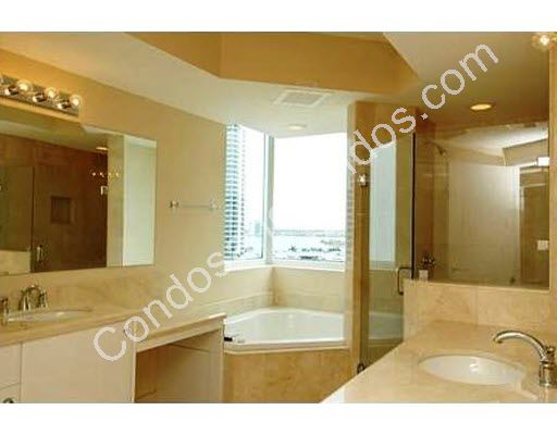 Master bathroom including jacuzzi tub and separate glass shower