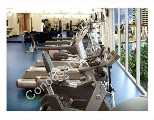 Cardio equipment overlooking the pool
