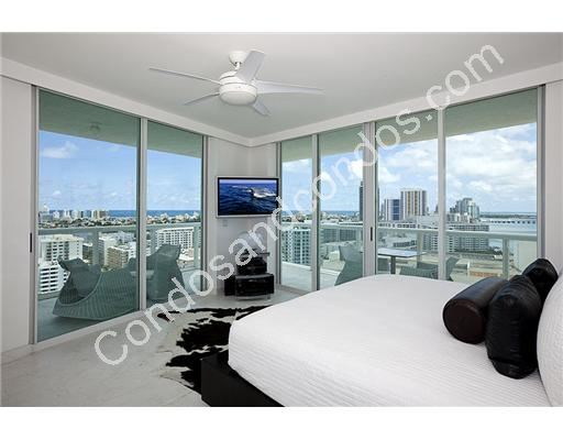 Modern master bedroom with city and bay view