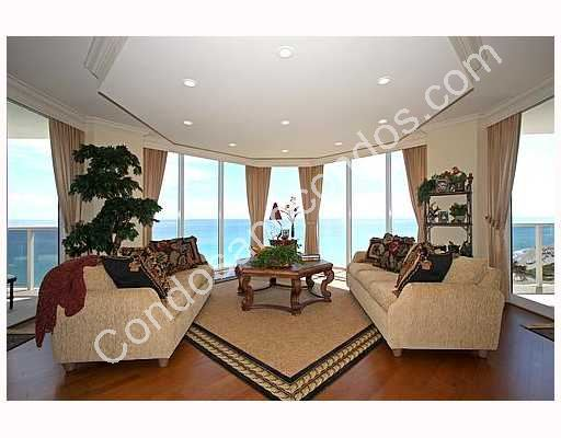 Living room with wrap around ocean view