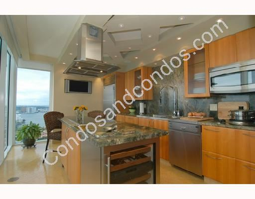 Kitchens include granite counter and island tops