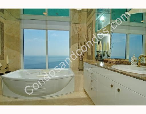 Master bathroom include Whirlpool tub and marble surfaces