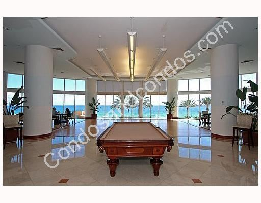 Opulent recreation hall with billiard table