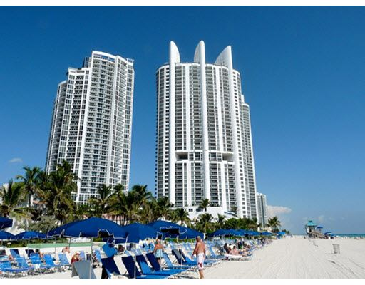 The Trump International Beach Resort And Royal Soaring Over White Sandy Beaches