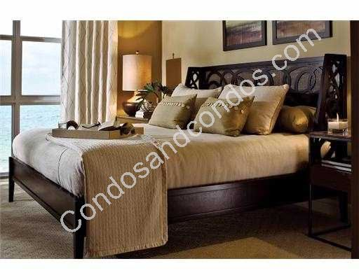 Designer furnished master suite