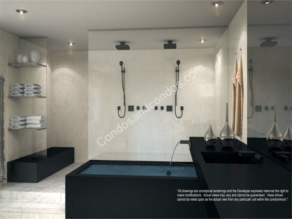 Glass-walled marble showers w/ Grohe fixtures & Jacuzzi whirlpool