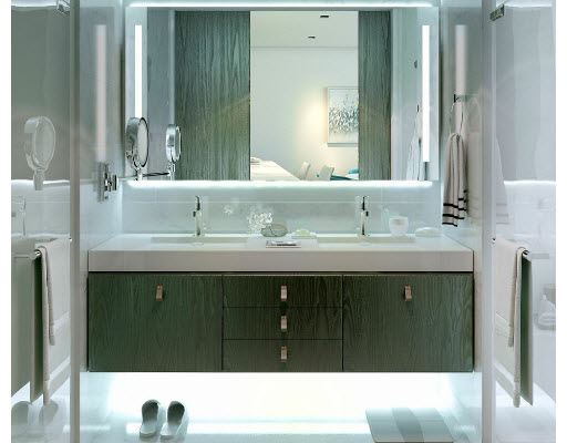 Dual sinks and Spa-like amenities. Soaking tubs in Masters and custom-finished floors & walls in wet areas