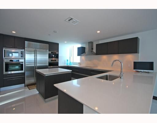 Sub-Zero & Miele stainless steel appliances. Snaidero wood & glass cabinets