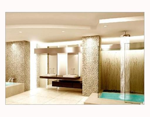 Framelss glass enclosed showers with overhead rainfall & hydrotherapy tubs
