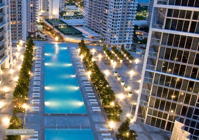 View of pool from Viceroy condo-hotel by night