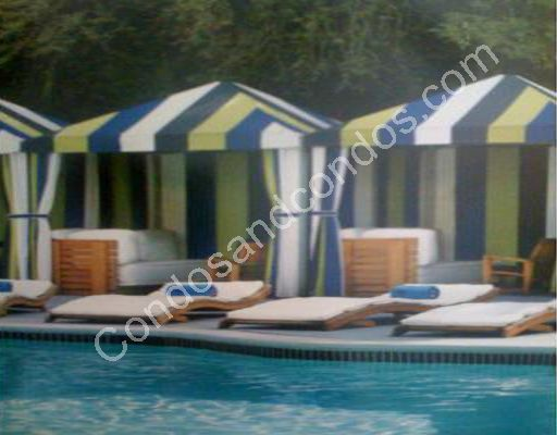 Relax or entertain pool-side in a private tent