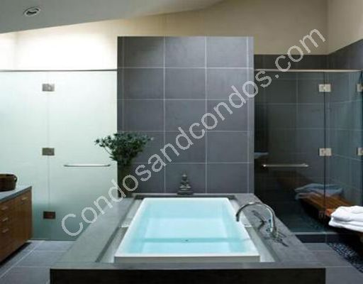 Premium whirlpool spa bathtub and separate shower in all master bathrooms
