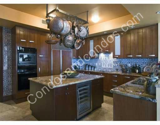 Kitchens include granite counter-tops and stainless steel appliances
