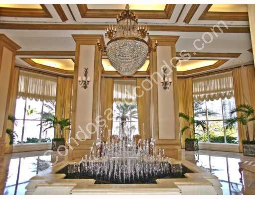 Dramatic lobby entrance with water fountains