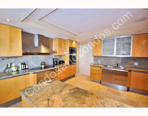 Spacious kitchen with granite counter-tops