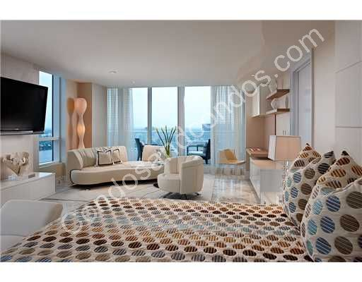 A modern furnished master suite with ocean view
