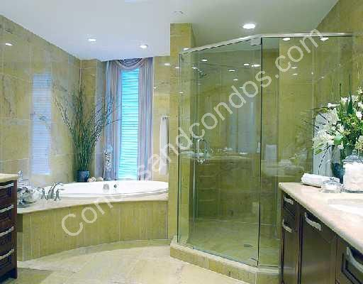 Opulent master bathroom with spacious shower and detached bath