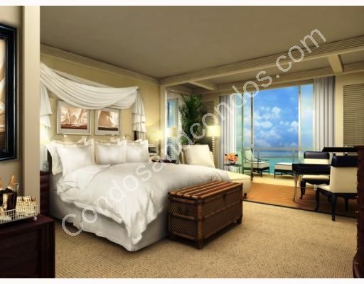 Plush master suite with private balcony and ocean view