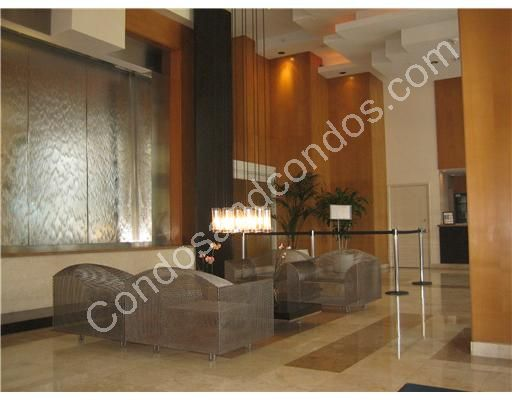2 story wood and marble lobby with waterfall wall