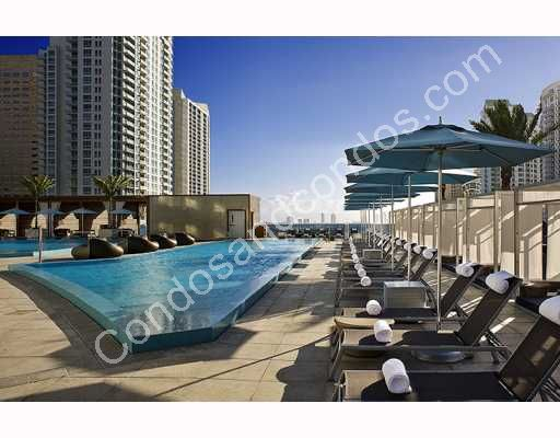 16 floors up, the 13,000+ sq ft wrap-around pool deck boasts water & city views