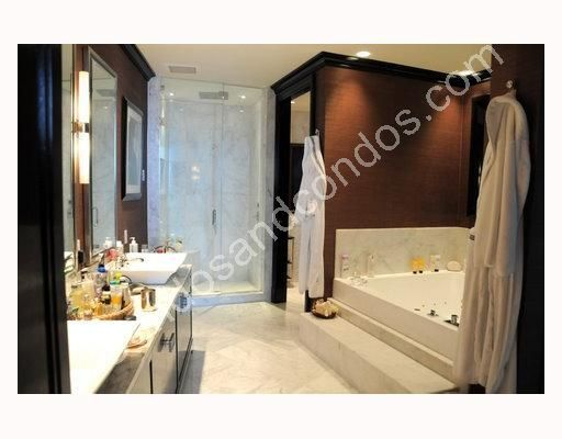 Imported Italian marble floors, baseboards, shower, and tub walls