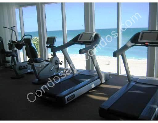 Fitness center looks out to the beach