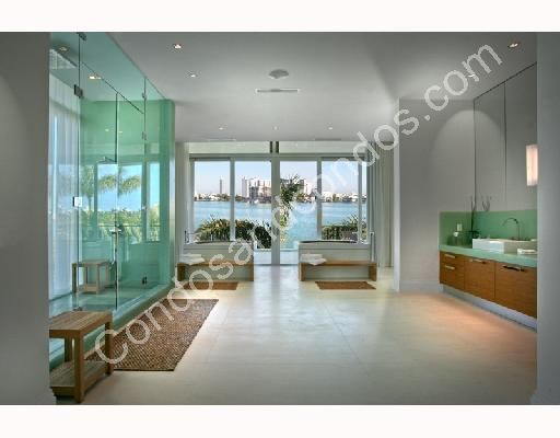 Grandiose master bath with soaking tubs and over-sized glass shower