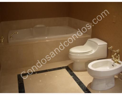 Bathroom with Chiampo Marble floors and bidet