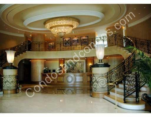 Dramatic 2-story lobby with grand stairwell