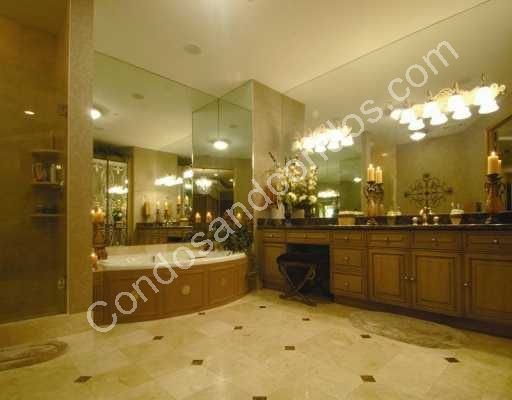 Opulent His and Her bathrooms with imported marble floors
