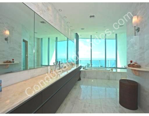 Large marble top vanity and ocean view from master bath