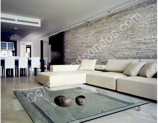 Living and Dining area with stone backdrop