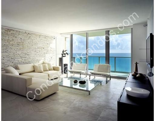 Modern living area with marble floors and ocean view