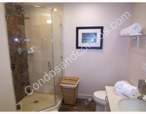 Baths include rainfall shower heads and separate whirlpool tubs