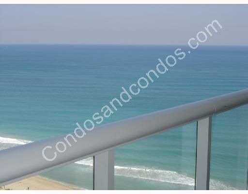 Expansive private balconies with glass railings