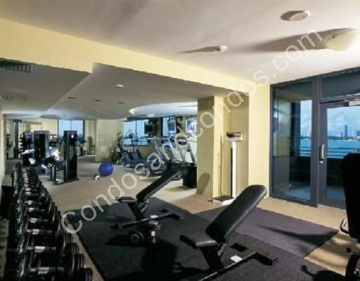 Fully stocked fitness center overlooking the bay
