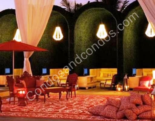 Outdoor lounge and cabanas illuminated at night