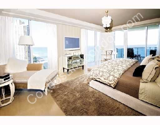 Master bedroom with private balcony, city and ocean views