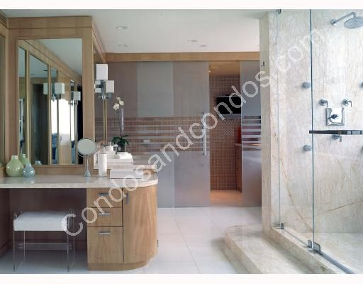 Spa style master bathroom with glass shower and private tub