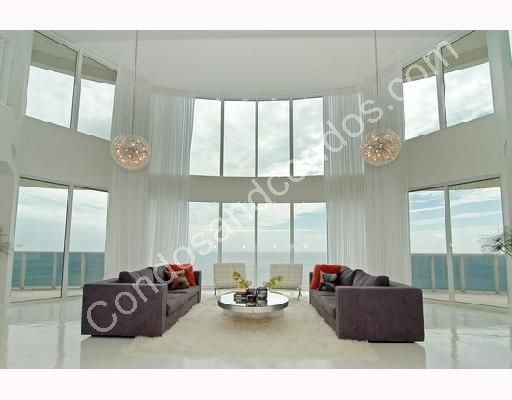 Grand living room with designer light fixtures