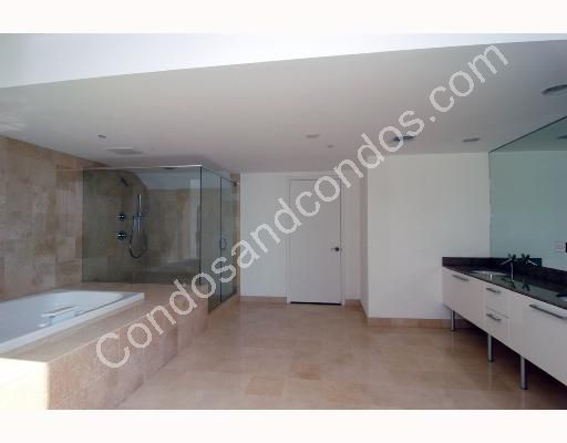 Spacious master bathroom include Whirlpool tub and glass shower