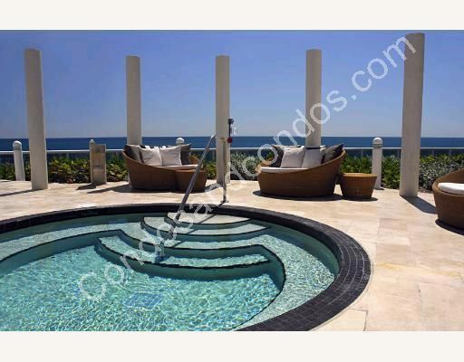 Oceanfront Jacuzzi and lounge chairs