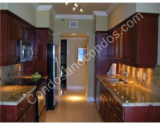 Imported Italian walnut cabinetry and granite counters