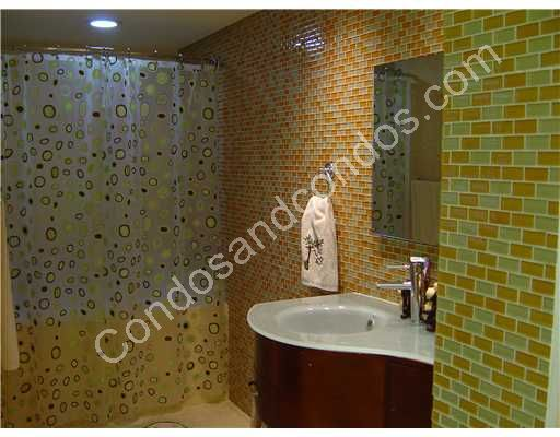 Bathroom with glass tile surface