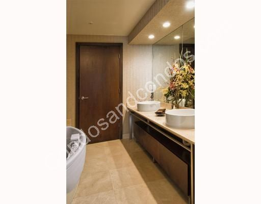 Spa bath and dual sink vanity with full mirror