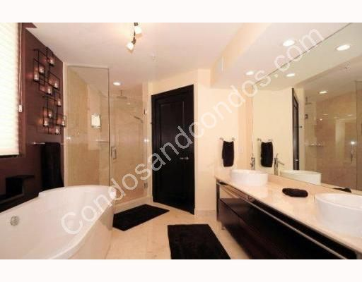 Master bathroom includes spa bath and marble surfaces