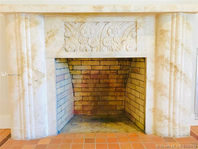 Beautiful Stone Mantel surrounding working fireplace